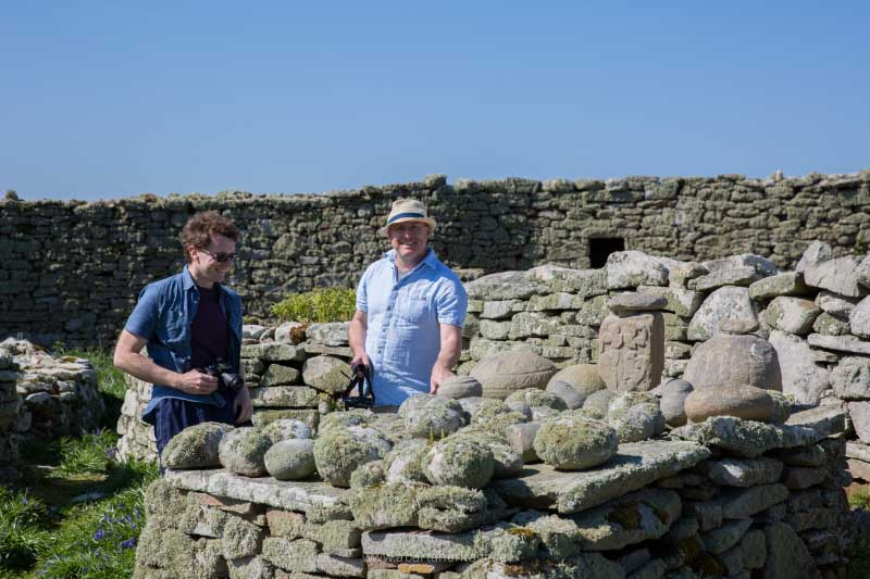 Dr James Bonsall and Dr Ros O Maolduin trying out the Cursing Stones