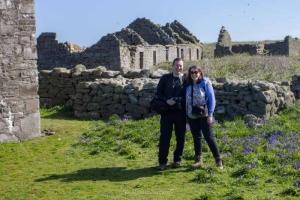 Neil Jackman and Roisin Burke of Abarta Heritage enjoying the sun on Inishmurray