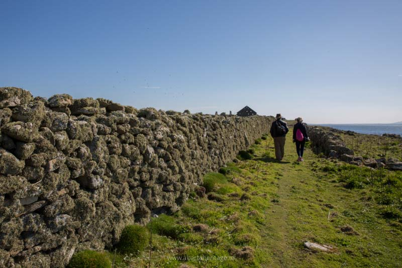 Walking up the path from Clashymore towards the deserted village on Inishmurray