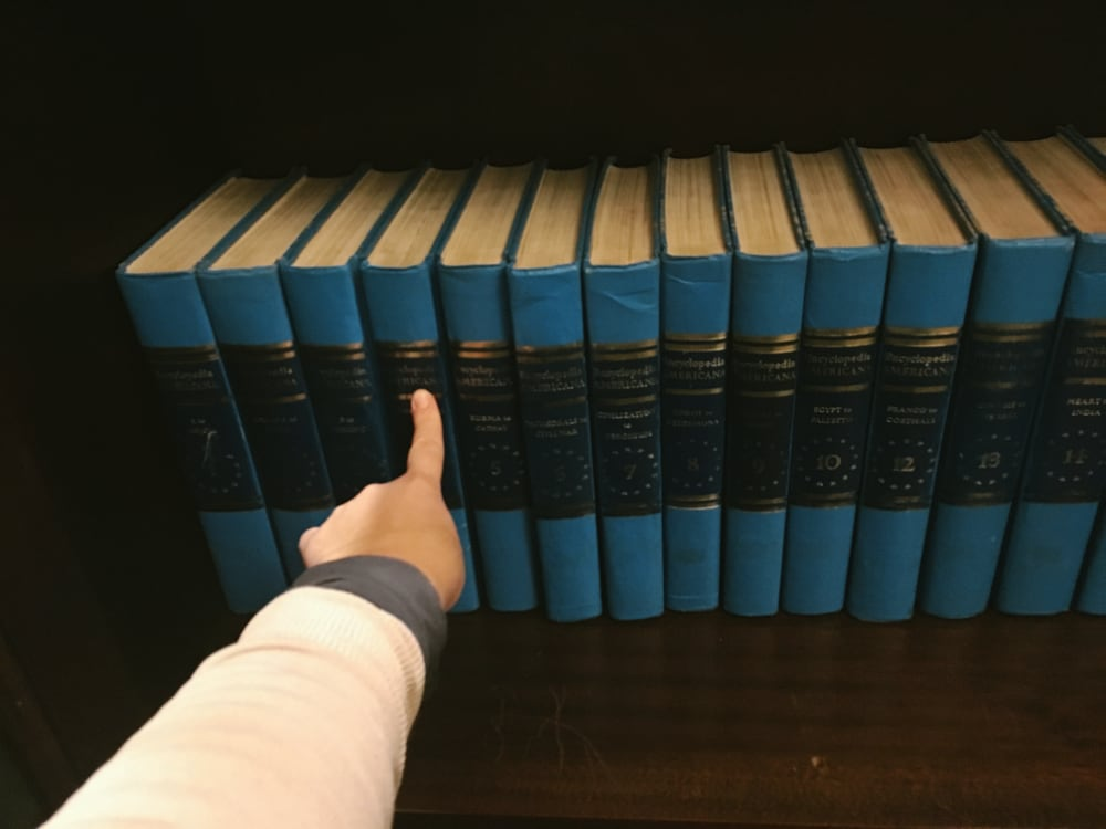 Robert Boyle Escape Room finger points at encyclopedia