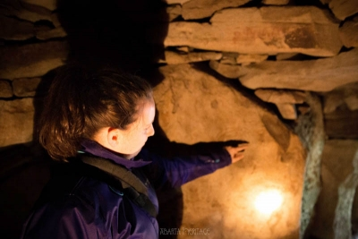 Róisín of Abarta Heritage inside the 5000 year old tomb of Cairn T at Loughcrew. The Boyne Valley has some of the best examples of passage tombs in Ireland