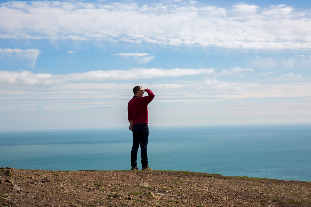 Man looking out to sea - Ground Research for Wicklow Brochure Design