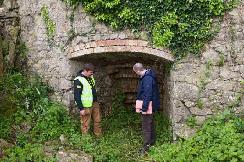 Stonemason Eoin Madigan and Conor Ryan Abarta Heritage inspecting Kilmurray Lime Kiln in County Clare